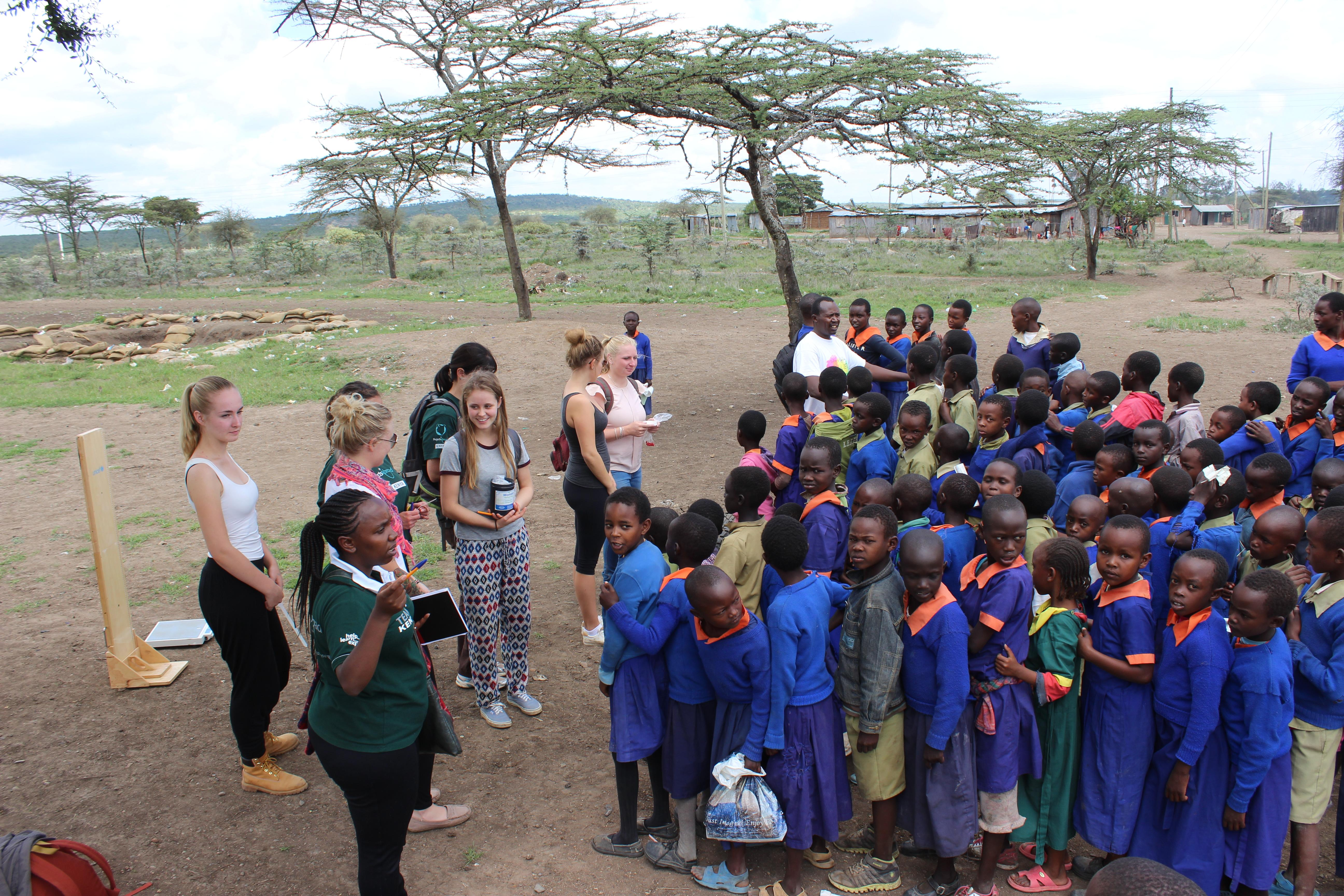 A group of medical Projects Abroad interns preparingto screen and treat local children during their nursing internship in Kenya.